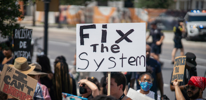 Fix the system protest sign