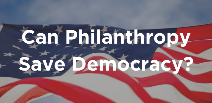 "American flag with writing ""Can Philanthropy Save Democracy"""