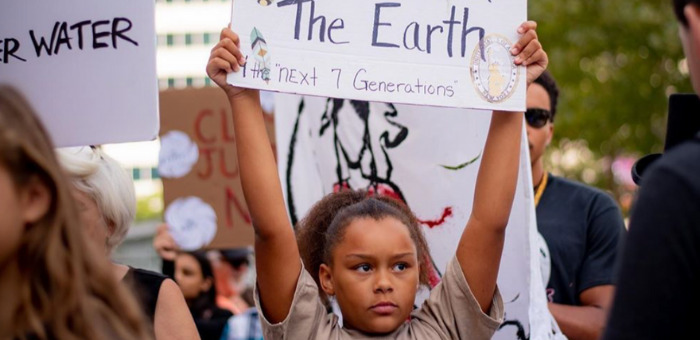 Child holding up a sign at a climate protest