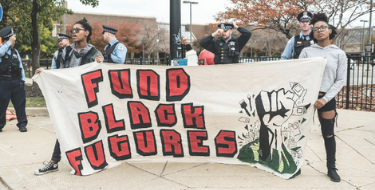 a group of people holding a banner that says fund black futures