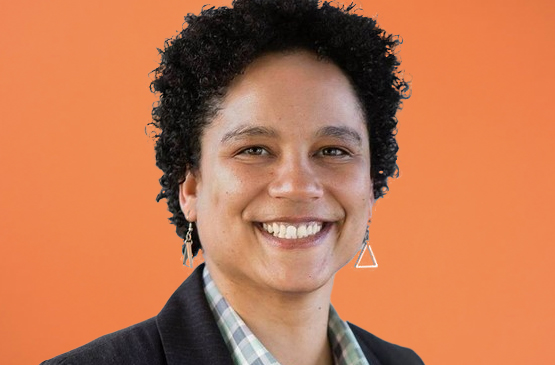 Photo of Kathryn Snyder on an orange background