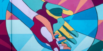 colorful mural of two hands together open palms up